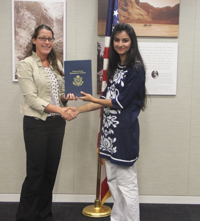 Maham Zahid, SUSI Alumna 2014 receiving certificate on completion of exchange program from Macon E. Barrow, ‎Academic Exchange Specialist at State Department