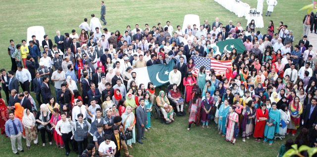 Participants of PUAN Islamabad Chapter Reunion carrying Pakistani and American Flags