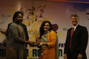 AEIF Winner Sana Ejaz receiving an award from Deputy PAO Kedenard Raymond