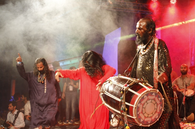 Pappu Saeen drumming the dhol in his unique style accompanied by his band and dancers at Day 2 of Music Mela 2015