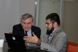 Fulbright Alumnus Dr. Zeeshan-ul-Hassan Usmani showing the software to Former U.K Prime Minister Gordon Brown