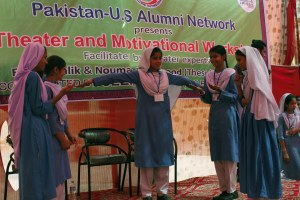 Students role-playing a situation in front of a live audience at the government school in Liaquatabad