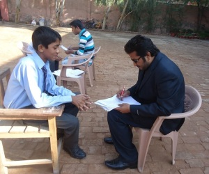 A mentor asking a series of questions from a student at Merry Rose School