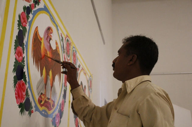 Truck artist creating his magic at Natasha Jozi's exhibition